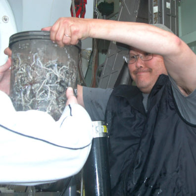 Associate professor Ray Lee, scientific director of the cruise, unloads the biobox holding tube worms and other deep-sea creatures picked up from Alvin's mechanical arms. Photo courtesy John Rutherford.