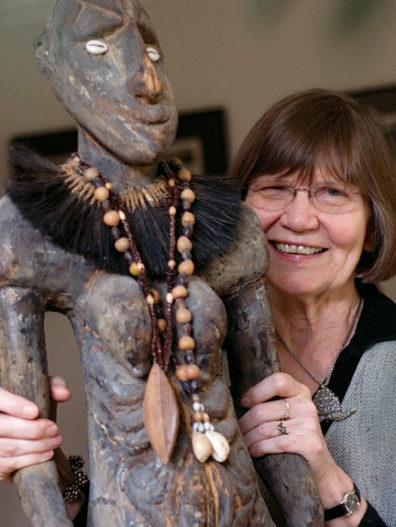 Ellen Dissanayake with a carving of a 'yam goddess' from Papua New Guinea