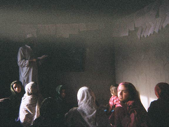 Young ladies gather in what looks like a classroom setting in Laghman.