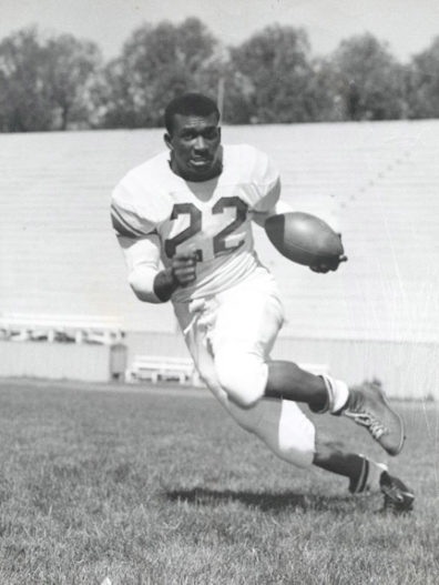 Duke Washington on the field playing football