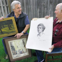 Bob Brumblay (left) and Dave Fitzsimmons holding works by Griffin