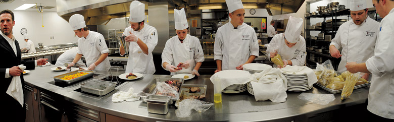 WSU students prepare a Feast of the Arts dinner in the College of Business's commercial kitchen