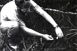 Dr. Carl Gustafson examining stone flake found below Mazama ash
