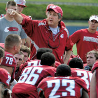 Mike Leach coaching WSU football players in 2012
