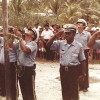 Bryan Vila (second row) joins police officers—his trainees—in a 1979 ceremony to celebrate Kosrae's status as a state in the newly formed Federated States of Micronesia. Courtesy Bryan Vila