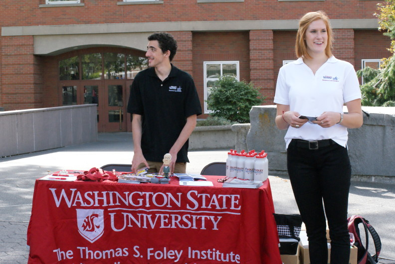 Stephanie Logan and a fellow student at Constitution Day in 2014. At the Foley-sponsored event, students hand out pocket Constitutions and other Foley gear on campus. Courtesy Stephanie Logan