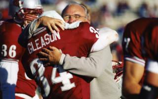 Former WSU coach Mike Price embraces Gleason after a big play (courtesy WSU Athletics)