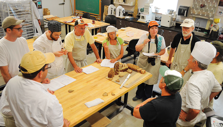 Jeffrey Hamelman of King Arthur Flour (in the white chef's hat) leads a local grains workshop at the Bread Lab. (Photo Kim Binczewski)