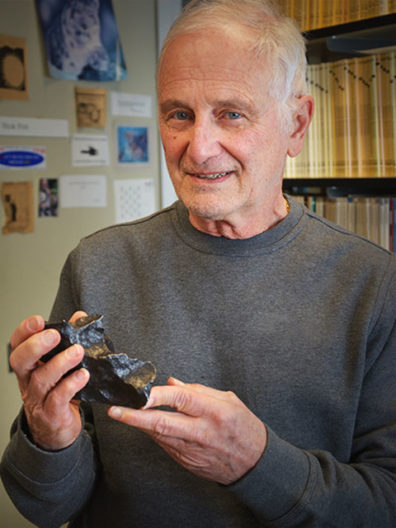 Nick Foit holding a meteorite. Staff photo