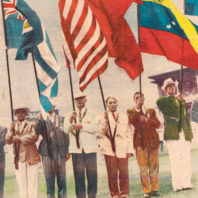 WSC Olympic boxing gold medal winner Pete Rademacher '53 carries the U.S. flag in the closing ceremony of the 1956 Summer Games