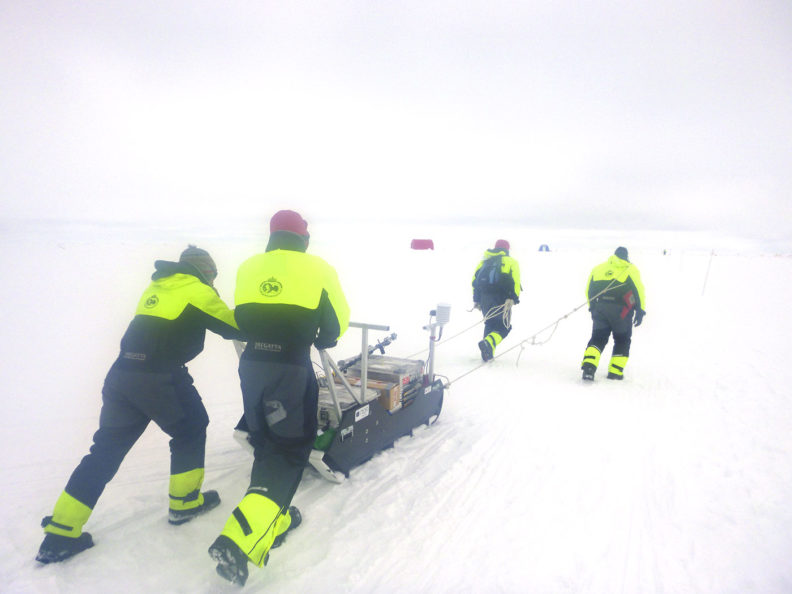 A team of scientists deploy instruments to study conditions in the Arctic in 2015.