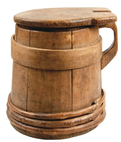 Late 1700s staved wooden tankard in pine construction, typical of New England. From listing by Early American at liveauctioneers.com.