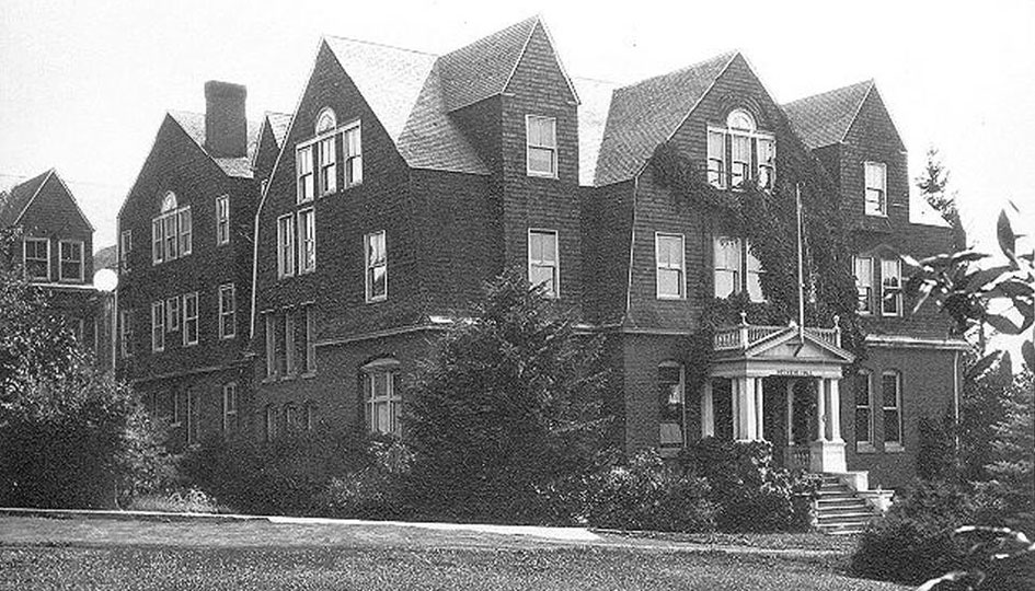 Stevens Hall, c. 1915 - Looking south over a grass lawn at the north entrance to Stevens Hall.