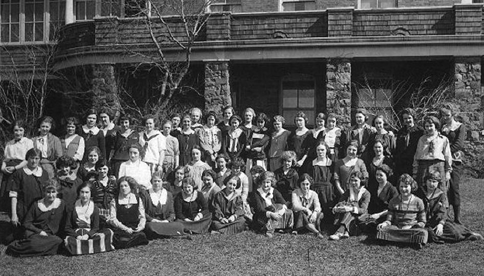 Stevens Hall, 1922 - A group portrait of the residents, posed on the grass in front of the West façade of Stevens Hall.