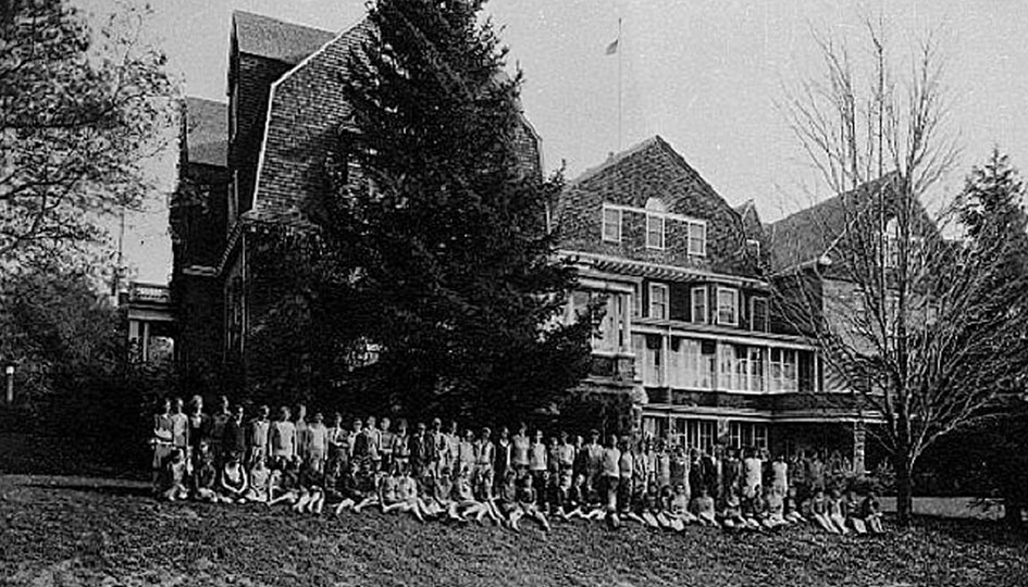 Stevens Hall, 1928 - A group portrait of female students on the lawn in front of the west facade of Stevens Hall.