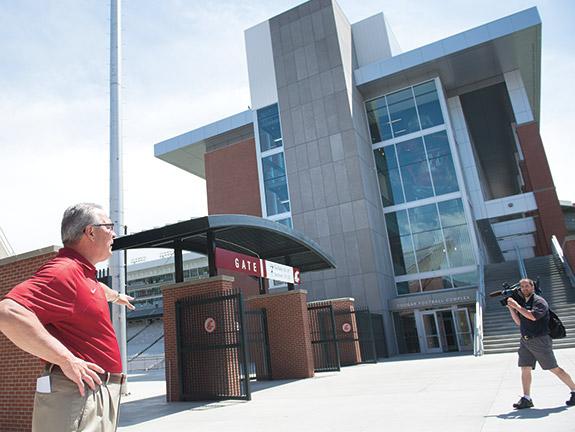 Bill Moos by football building