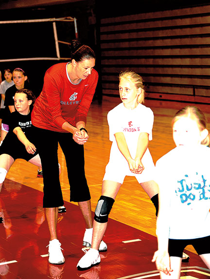 WSU volleyball coach at camp