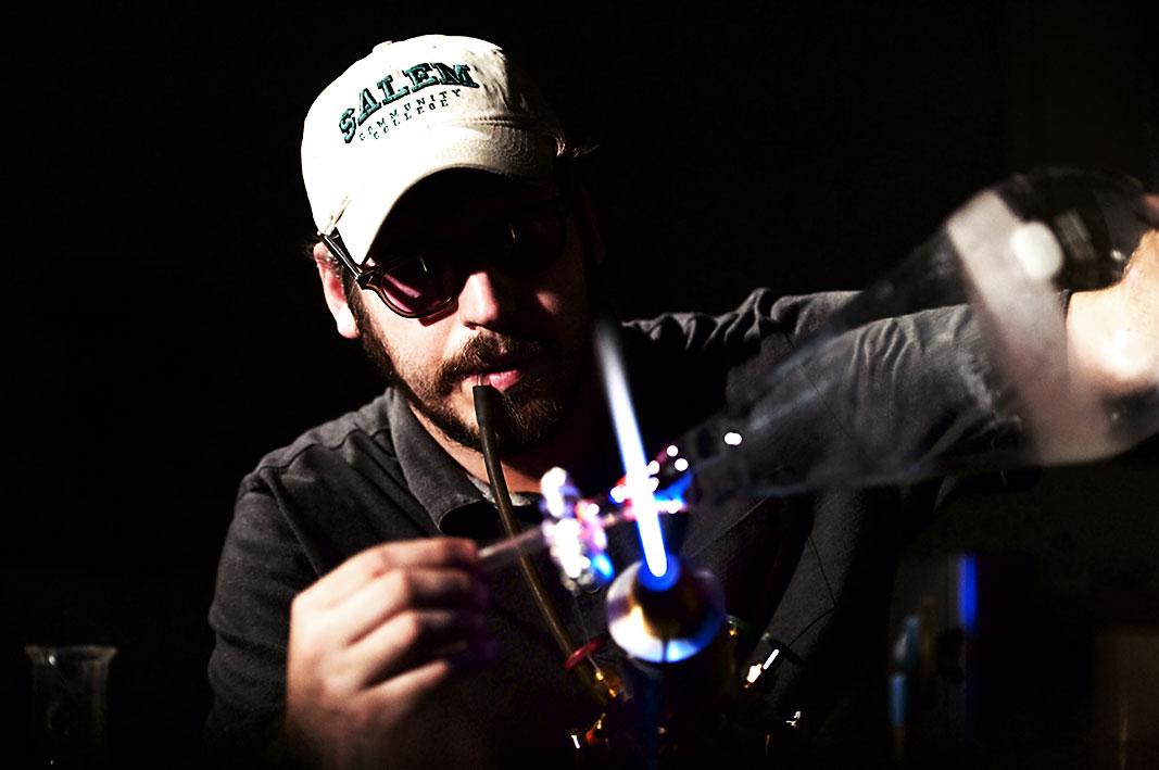 Aaron Babino repairing glassware