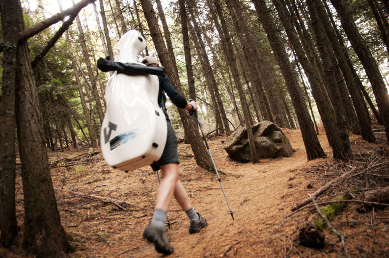 Ruth Boden hiking with her cello. Photo Zach Mazur.