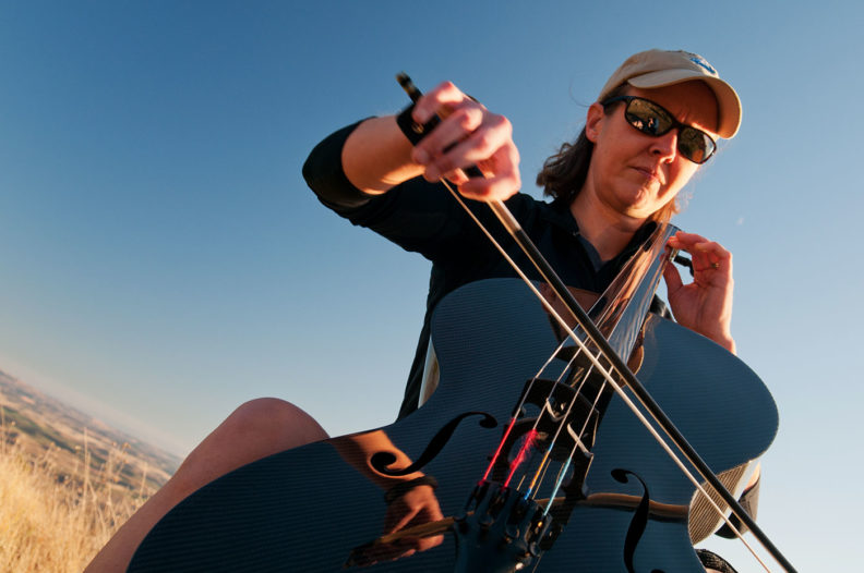 Ruth Boden plays cello on Kamiak Butte. Photo Zach Mazur.