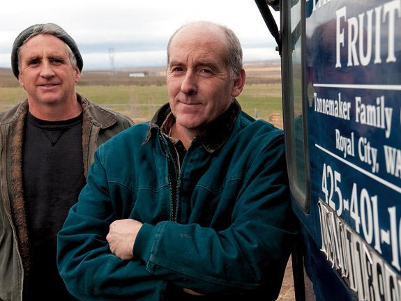 Kurt Tonnemaker '84, right, and his brother Kole at their Royal City farm