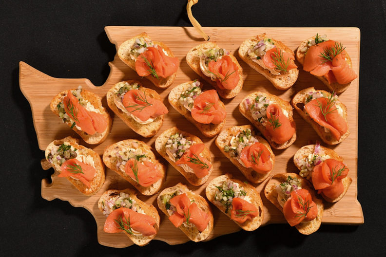 Salmon crostini on Washington state shaped board