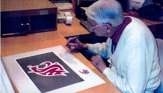 Randall Johnson signing WSU logo poster