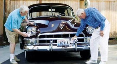 Two men polishing a classic car