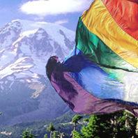 Gay Pride flag in front of Mt. Rainier