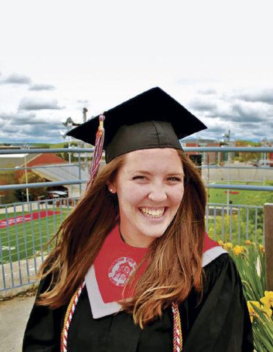 Becca Prescott in WSU graduation robes
