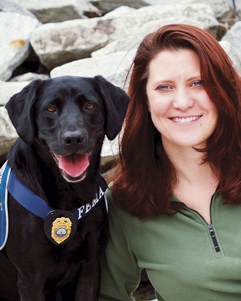 Jennifer Brown and a FEMA search and rescue dog