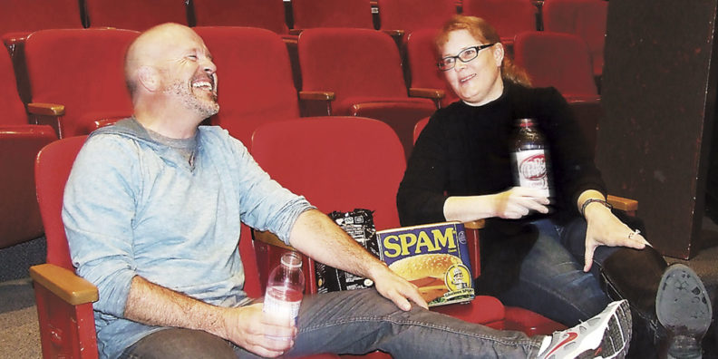 Paul and Kelly Atwood laugh at theater
