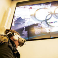 A WSU student takes a virtual trip to the 2018 Winter Olympics. Photo Robert Hubner