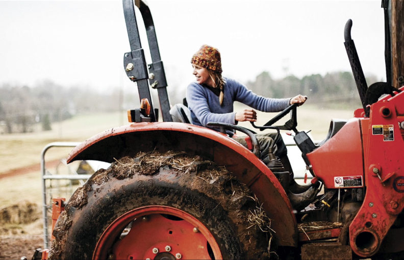 Woman farmer on tractor