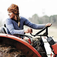 Woman on tractorL frame from Women's Work: The Untold Story of America's Female Farmers documentary