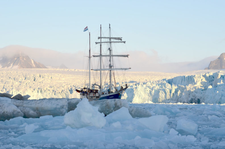 Tall ship Antigua in a fjord near Svalbard. Photo Debbie Lee