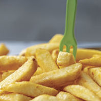 French fries with a fork. Photo Gilly/Unsplash