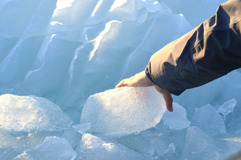 Holding a chunk of ice. Photo Debbie Lee