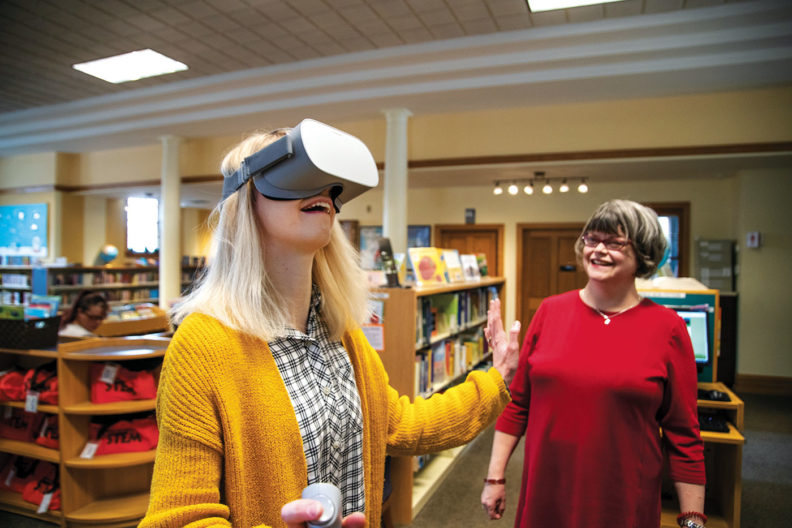 Sarah English introduces a patron to virtual reality at Colville Public Library
