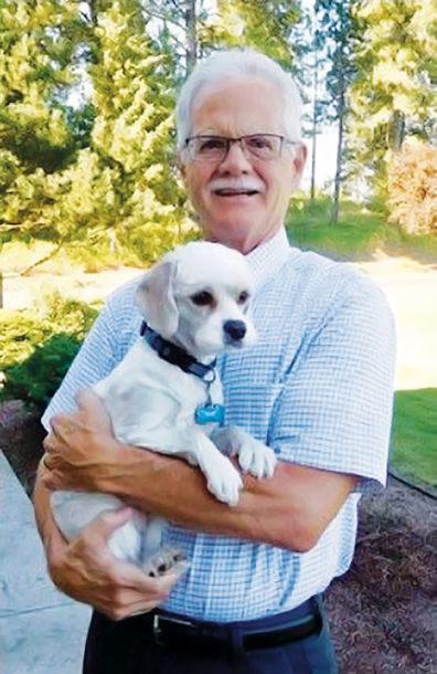 Robert Slack holding a dog