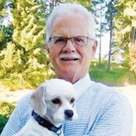 Robert Slack DVM holding a dog