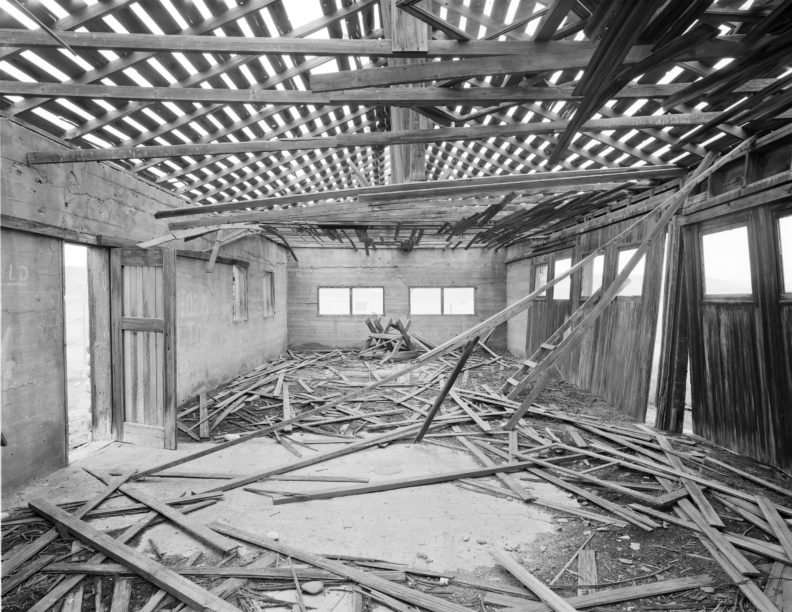 Interior of the Bruggemann Warehouse on the Hanford Reservation with collapsed beams