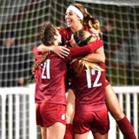 WSU soccer players celebrate a goal