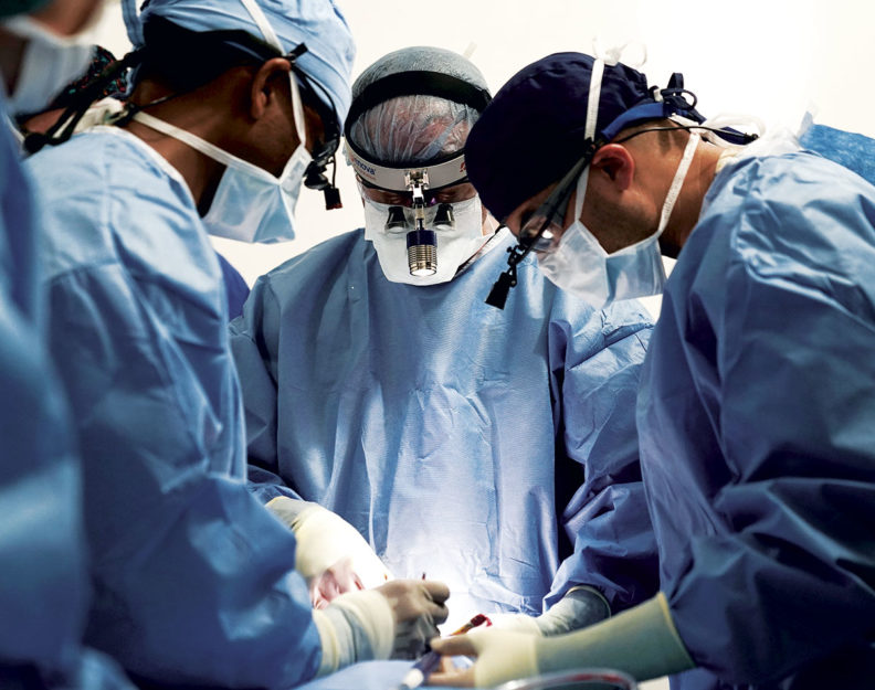 Doctors performing surgery in Guatemala.