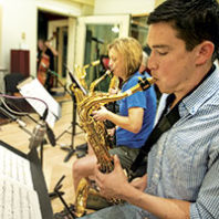 Students play saxophones at WSU recording studio