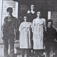 Five children stand in front of Riviera School circa 1917