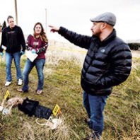 Matt DeGarmo critiquing forensic science students on their crime scene investigation in a field lab at Blue Mountain Community College in Pendleton, Oregon.
