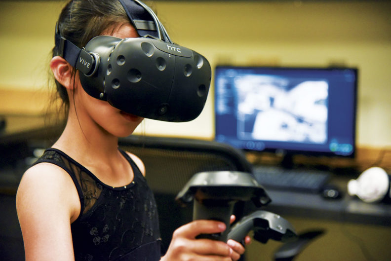 A girl tries out VR at WSU Tri-Cities