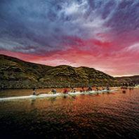 WSU men's crew on the Snake River at dusk