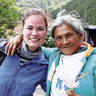WSU journalism alumna Andrea Castillo in Colombia with a refugee from Venezuela